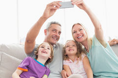 Parents taking selfie with children Royalty Free Stock Photography