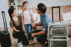 Parents Talking with Smiling Little Girl at Home. Happy Man and Woman. Smiling Little Girl. Smiling Family at Home. Smiling Person. Family with Child. New royalty free stock image