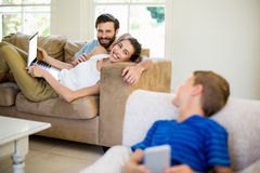 Parents talking to a son while using laptop. At home stock photography