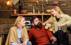 Parents talking to their teenage daughter, family concept. Bearded man and his blond wife worried about their child. Parents talking to their teenage daughter royalty free stock images
