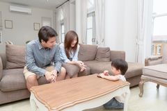 Parents teach children to keep toys after play. In living room royalty free stock photos