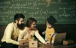 Parents Teaches Son, Chalkboard On Background. Modern Education Concept. Smart Child In Graduate Cap Likes To Study Stock Photography