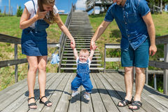 Parents teaching baby boy to walk.  Royalty Free Stock Photos