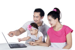 Parents teaching child using laptop Royalty Free Stock Photography