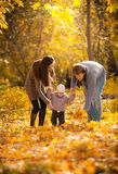 Parents teaching small daughter to walk at park Stock Photography