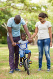 Parents teaching son bicycle Royalty Free Stock Photos
