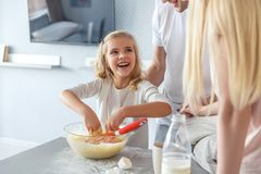 parents teaching their adorable happy daughter stock photography