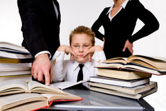 Parents teaching their tired son royalty free stock image