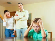 Parents and teen son after quarrel at home Royalty Free Stock Images