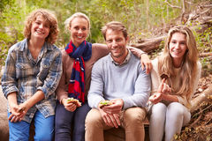 Parents and teenage kids eating outdoors in a forest, portrait Royalty Free Stock Images