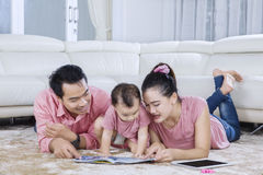 Parents telling story to child Royalty Free Stock Photo