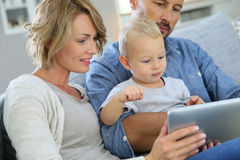 Parents and their baby boy using tablet at home Royalty Free Stock Image
