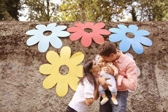 Parents with their baby girl in the park. Playful parents with their baby girl in the park Stock Photography