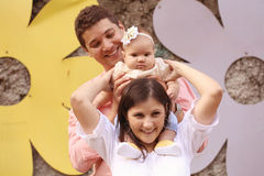 Parents with their baby girl in the park. Playful parents with their baby girl in the park Stock Photos