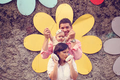 Parents with their baby girl in the park. Playful parents with their baby girl in the park Stock Photo