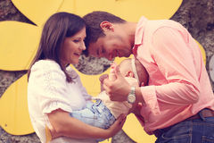 Parents with their baby girl in the park Royalty Free Stock Photos