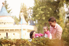 Parents with their baby girl in the park Stock Image