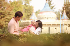 Parents with their baby girl in the park Stock Photos