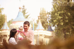 Parents with their baby girl in the park Stock Photography
