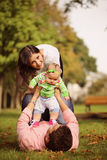 Parents with their baby girl in the park Royalty Free Stock Photo