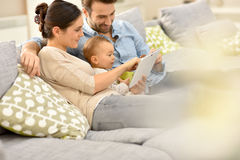 Parents and their baby using tablet at home Royalty Free Stock Images