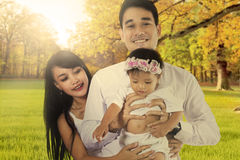 Parents and their child at autumn park Royalty Free Stock Photos