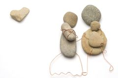 Parents with their children. Made from pebbles Royalty Free Stock Photo