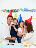 Parents with their children at a birthday party. Portrait of parents with their children during a birthday party at home stock images