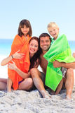 Parents with their children in towels Stock Photo