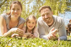Happy family outdoor with their daughter. stock photo