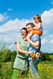 Parents and their daughter in meadow Stock Photography