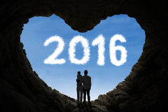 Parents and their kid inside cave with numbers 2016 Stock Images