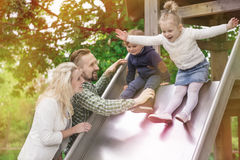 Parents with their kids in park Stock Photo