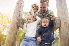 Parents with their kids on playground Stock Photography