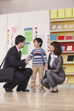 Parents with their Son in Classroom Royalty Free Stock Image