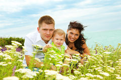 Parents and their son on hill Royalty Free Stock Photo