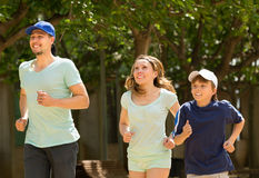 Parents with their son  jogging in the park Royalty Free Stock Image