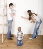 Parents with their son near ladder Royalty Free Stock Photos