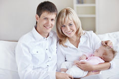 Parents with a tiny baby Royalty Free Stock Photos