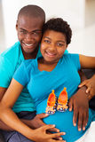 Parents to be. Happy young african american parents to be at home Stock Photography