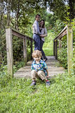 Parents and toddler on bridge outdoors Stock Images