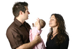 Parents trying to comfort a restless baby girl. Two parents trying to comfort a restless baby girl royalty free stock photos