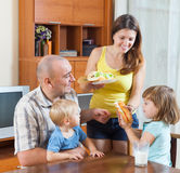 Parents and two children having lunch Royalty Free Stock Image