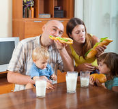 Parents and two children having lunch Stock Image