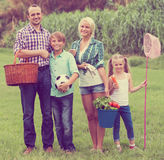Parents with two children at the lawn Royalty Free Stock Photos