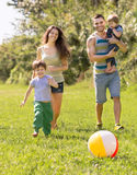 Parents with two children in the park Royalty Free Stock Photos