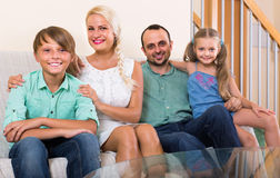 Parents with two children posing in home interior Royalty Free Stock Photos