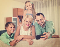 Parents with two children posing in home interior Royalty Free Stock Photo