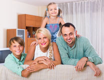 Parents with two children posing in home interior Royalty Free Stock Image