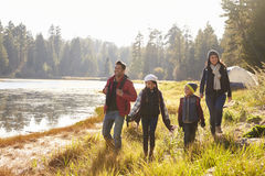 Parents and two children walking near a lake, close up stock images